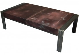 Three quarter view of an industrial table made with the hood of a Chevrolet Chevelle 1980 car.