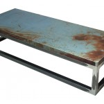 Three quarter view of an industrial table made with the trunk of a Chevrolet Nova 1976 car.