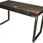 Three quarter view of an industrial table made with the trunk of a Chrysler Aries 1985 car.