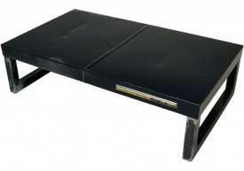 Three quarter view of an industrial table made with the trunk of a Chrysler New Yorker 1965 car.