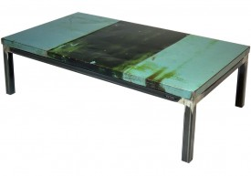 Three quarter view of an industrial table made with the trunk of a Dodge Dart 1966 car.