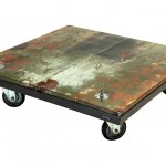 Three quarter view of an industrial table made with the hood of a Ford Comet 1966 car.