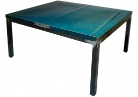 Three quarter view of an industrial table made with the hood of a Ford Galaxie 500 1968 car.