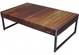 Three quarter view of an industrial table made with the hood of a GMC S15 Sierra 1982 car.
