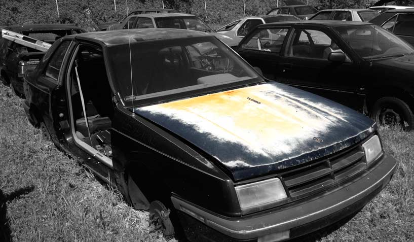 Dodge Shadow Es 1989 car on which the hood was taken and is available for the creation of an industrial table or artwork.