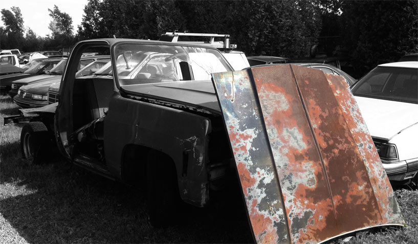 Unknown car hood available for the creation of an industrial table or artwork.