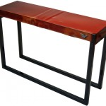 Three quarter view of an industrial table made with the hood of a Mercury M100 1968 truck.