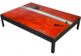 Three quarter view of a table made with the trunk of a Mercury Meteor Custom 1962 car.