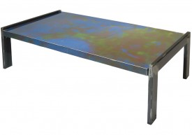 Three quarter view of an industrial table made with the trunk of a Plymouth Belvedere 1966 car.