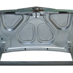 Underside view of a table made with the trunk of a Pontiac Star Chief 1955 car.