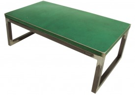 Three quarter view of an industrial table made with the trunk of green Chrvrolet Chevelle car.