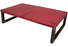 Three quarter view of an industrial table made with the trunk of a 1963 Plymouth Fury car.