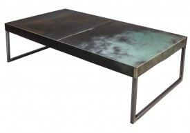 Three quarter view of an industrial table made with the trunk of 1980 Chrysler Newport.