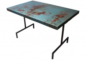 Three quarter view of an industrial table made with the trunk of a 1965 Chrysler 300 car.