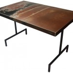 Three quarter view of a table made with a 1966 Plymouth Fury II car.