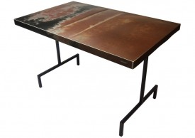 Three quarter view of a table made with the trunk of a 1966 Plymouth Fury II car.