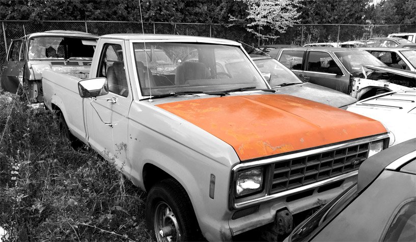 1982 Ford Ranger truck on which the hood was taken and is available for the creation of an industrial table or artwork.