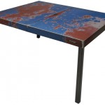 Three quarter view of a table made with the hood of an unknown blue and red car by Oxyd Factory.